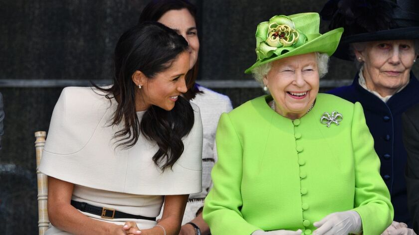 The Duchess of Sussex, left, and Queen Elizabeth II at the unveiling of the new Mersey Gateway Bridge in England.