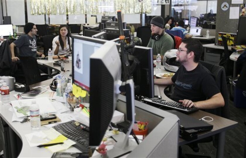 Zynga employees work in their San Francisco office.