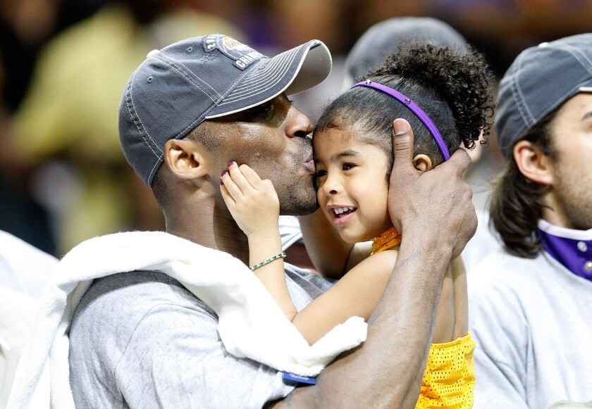 Kobe Bryant and Gianna after Game 5 of the NBA Finals in 2009