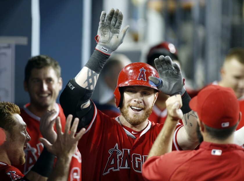 Josh Hamilton, shown celebrating a solo home run with his Angels teammates in August, might have many supporters within the organization, but owner Arte Moreno doesn't seem to be one of them.