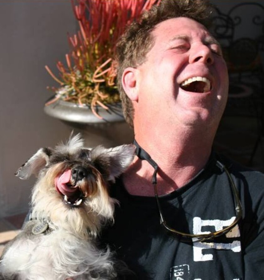 Chris Cott, pictured with one of his dogs, Gus, works to return lost dogs to their homes.