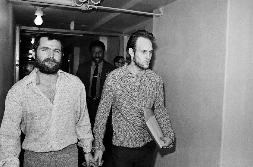 """FILE - This Dec. 22, 1970 file photo shows Charles Manson followers Bruce Davis, left, and Steve Grogan leaving court after a hearing in Los Angeles. Gov. Jerry Brown has rejected parole for Davis a follower of cult leader Charles Manson 46 years after a series of bloody murders rocked Southern California, Friday, Jan. 22, 2016. Bruce Davis was convicted of the 1969 slayings of musician Gary Hinman and stuntman Donald """"Shorty"""" Shea. He was not involved in the more notorious killings of actress Sharon Tate and six others.(AP Photo/Harold Filan, File)"""