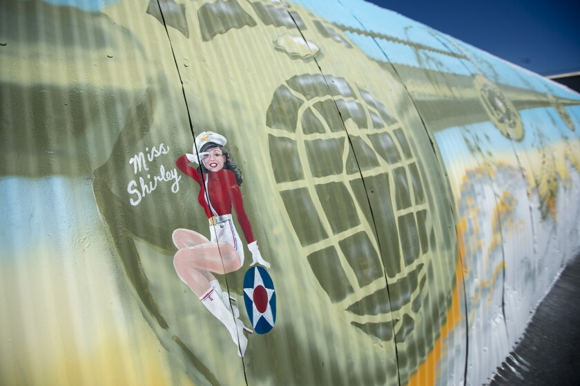 The artist Nancy Hadley, who painted a B-24 Liberator on the side of a Quonset hut, added her mother Shirley Walker to the mural.