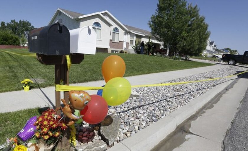 A 15-year-old boy was arrested in connection with the stabbing deaths of his two younger brothers, 4 and 10, at the family home in West Point, Utah. A memorial has take shape outside the home.