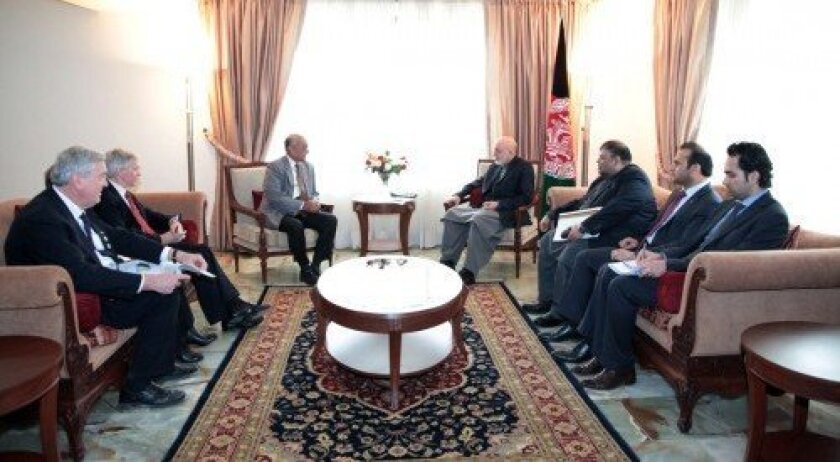 Steve Brown (far left) joins Rotary International President Kalyan Banjaree of India (left center) in a meeting with Afghanistan President Hamid Karzai. Brown, of Del Mar, helped facilitate the meeting, which focused on eradicating polio. Courtesy photo