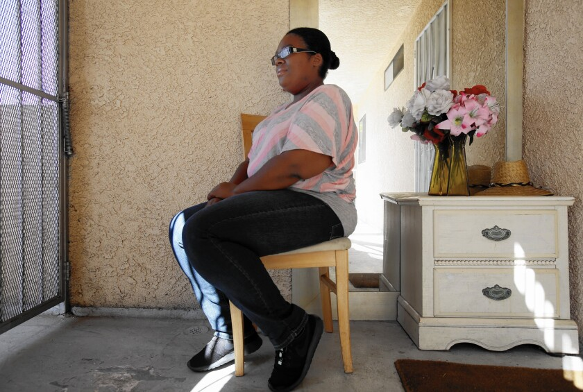 """Qiana Sago of Inglewood says the smartphone app that kept track of her diet and activity level helped keep her honest. """"You can't cheat. The phone showed that you did the work. It kept track every time you moved."""""""