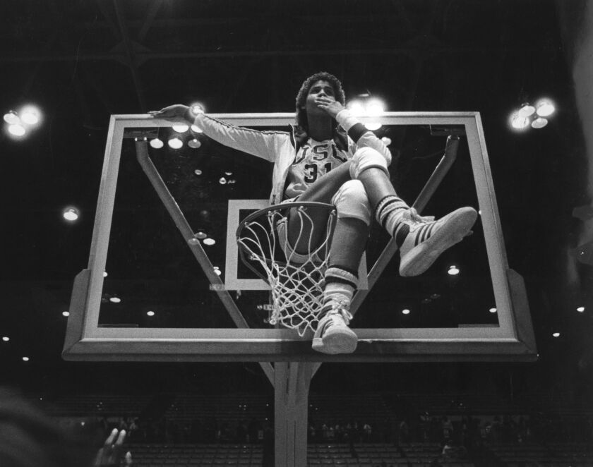 Cheryl Miller sits on top of the basketball hoop after the USC women's basketball defeated Louisiana Tech in the 1983 NCAA women's national basketball championship.