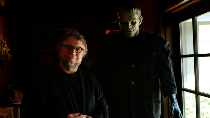 Guillermo del Toro and his 7-foot sculpture of Boris Karloff as Frankenstein's monster by artist Mike Hill.