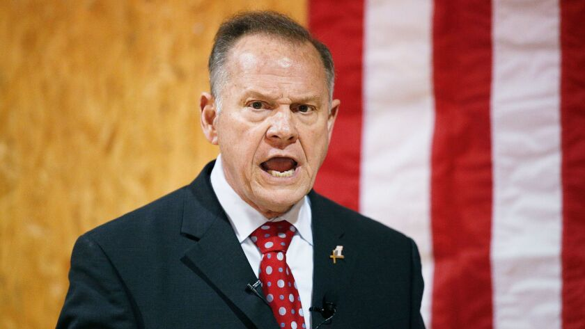 Former Alabama Chief Justice and U.S. Senate candidate Roy Moore speaks at a campaign rally, in Dora, Ala. on Nov. 30.