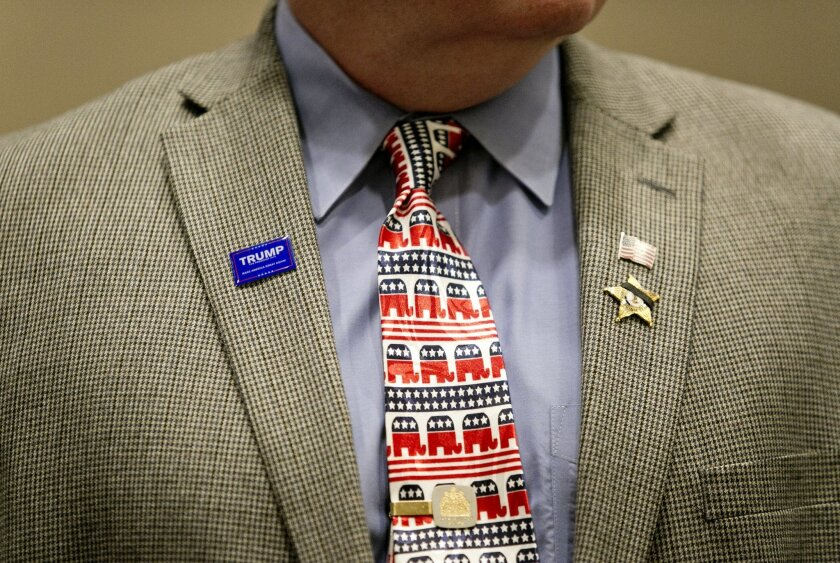 Visitors show their support for Republican presidential candidate Donald Trump prior to his speech at Westin Town Center in Virginia Beach, Va., Monday, July 11, 2016. (Kristen Zeis/The Virginian-Pilot via AP)