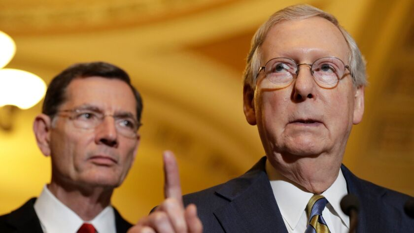 Senate Majority Leader Mitch McConnell, right, with Sen. John Barrasso (R-Wyo.)