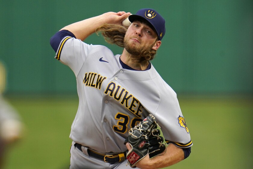Milwaukee Brewers starting pitcher Corbin Burnes delivers during the first inning of the team's baseball game against the Pittsburgh Pirates in Pittsburgh, Thursday, July 1, 2021. (AP Photo/Gene J. Puskar)