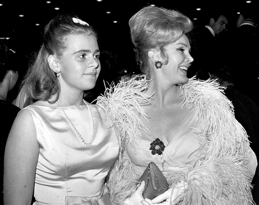 Francesca Hilton and Zsa Zsa Gabor arrive at a Hollywood premiere in 1963. In recent years Hilton battled her mother's ninth husband over Gabor's finances and medical care.