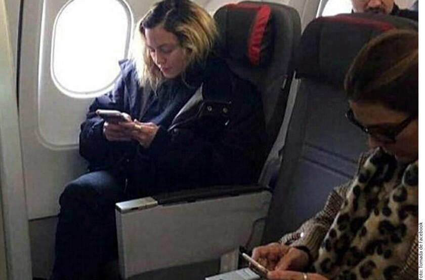 Madonna, en clase económica