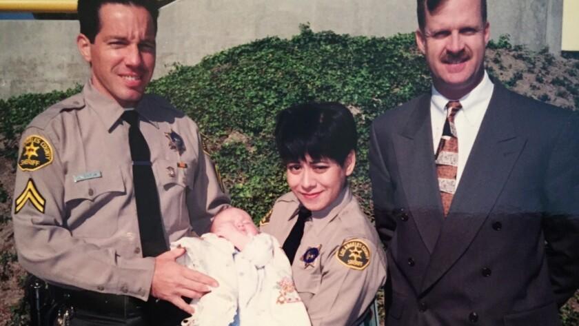 The photo w/ the baby: Alex Villanueva holding a friend's baby with his wife, Vivian Villanueva, at