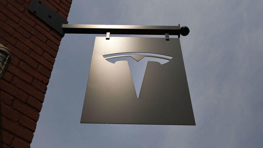 The Tesla logo hangs outside a showroom in New York City.