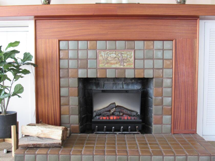 The Point Loma Assembly's refashioned fireplace captures the Craftsman style, which was growing in popularity when the hall was built in 1911.