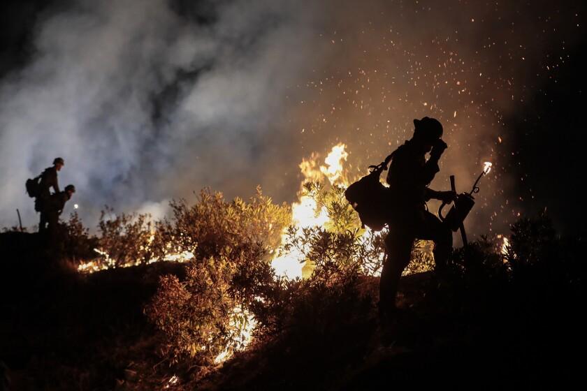 A hotshot firefighting crew battles the 2020 Bobcat fire