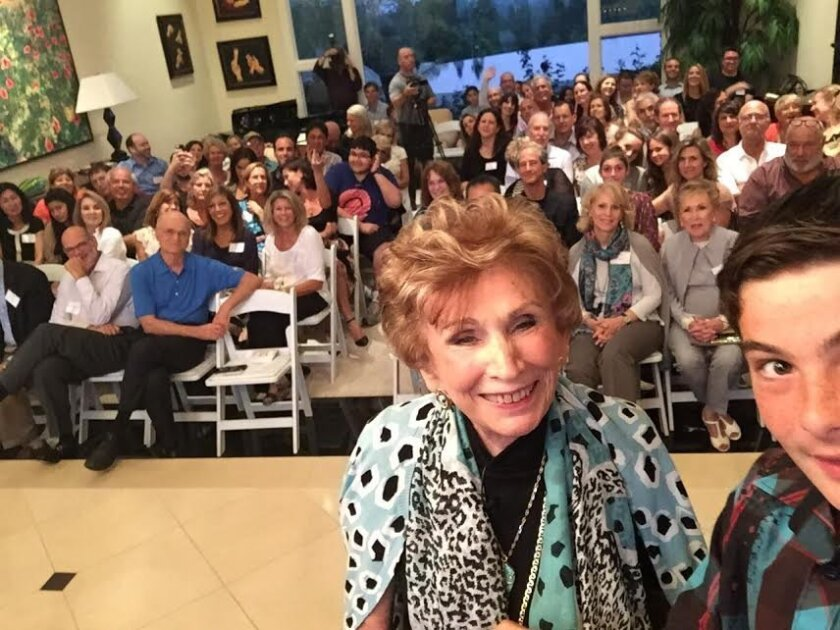 First lesson for Chai Tech: using a selfie stick. Aaron Benedek demonstrates with Holocaust survivor and psychologist Dr. Edith Eva Eger. Courtesy photo