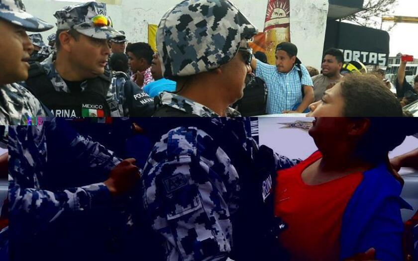 Un muerto y cerca de 600 detenidos han dejado por ahora las protestas iniciadas hace cinco días en México por el alza de los combustibles, en las que el descontento ha dado paso a saqueos y a una psicosis general por temor a actos vandálicos y toques de queda, amplificada por las redes sociales. Familiares de detenidos por saqueos se enfrentan a soldados de la Marina de México hoy, jueves 5 de enero de 2017, en Veracruz (México). EFE