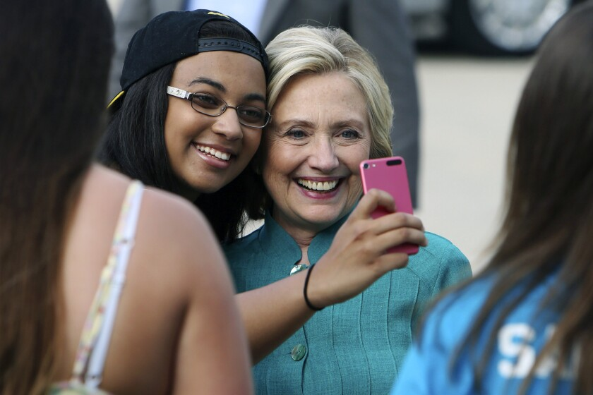 Democratic presidential hopeful Hillary Rodham Clinton poses for a selfie with Olivia Keller at a campaign house party Sunday in Burlington, Iowa. Typically, such events are covered by a small pool of reporters representing the full press corps.