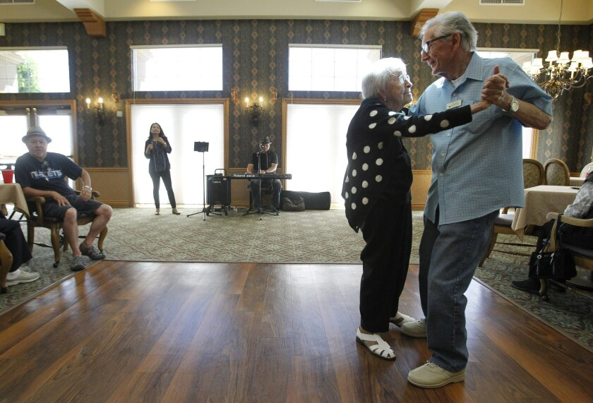 Agnes McKee's other interests include dancing in Fairwinds' dining room, as she did Thursday with a good friend and neighbor. / Photo by Hayne Palmour IV * U-T San Diego