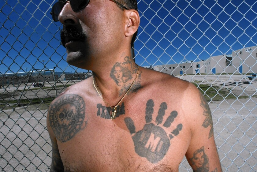 """Rene """"Boxer"""" Enriquez, former Mexican Mafia member, spoke for about an hour, detailing the businesslike structure of the gang and taking questions from the audience."""