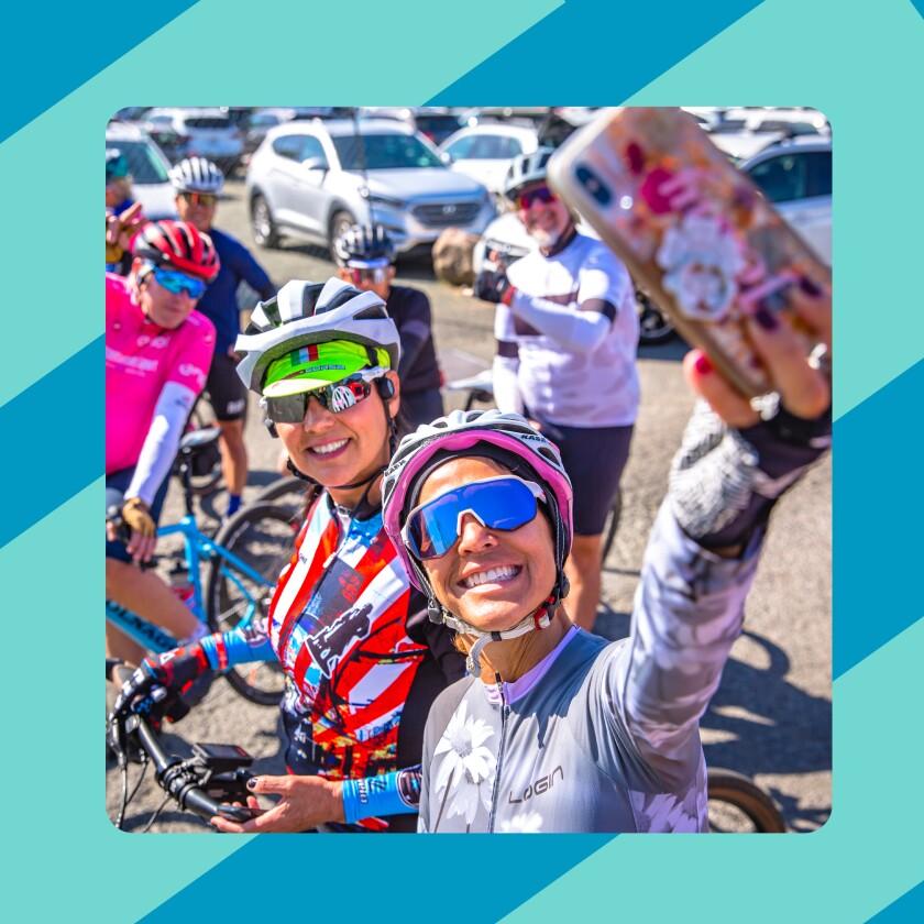 two women taking selfie on bicycle