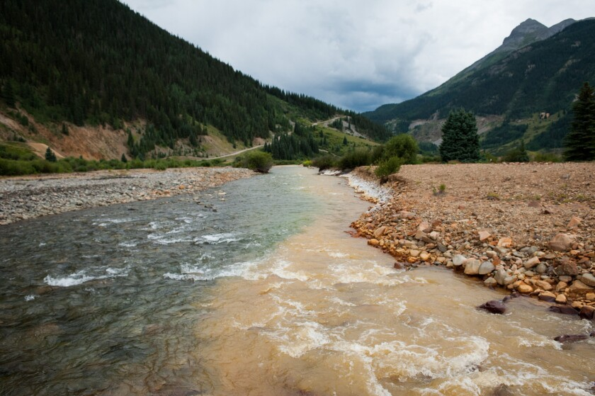 Cement Creek, which was flooded with millions of gallons of mining wastewater, merges with the Animas River in Silverton, Colo.