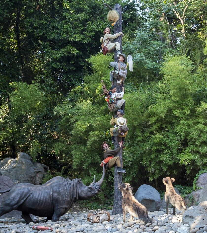Animals have an explorer treed in a Jungle Cruise scene