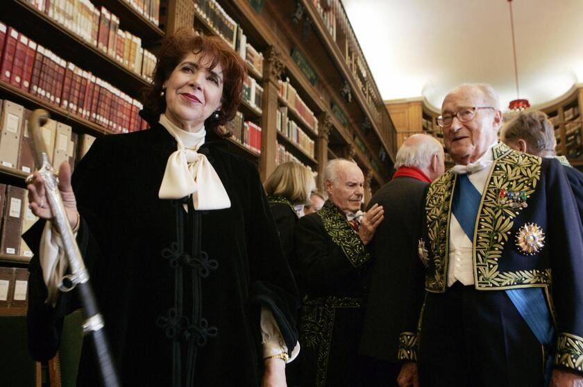 Assia Djebar, at left, was the first Algerian to be inducted into France's prestigious Academie Francaise. The writer and filmmaker has died at the age of 78.