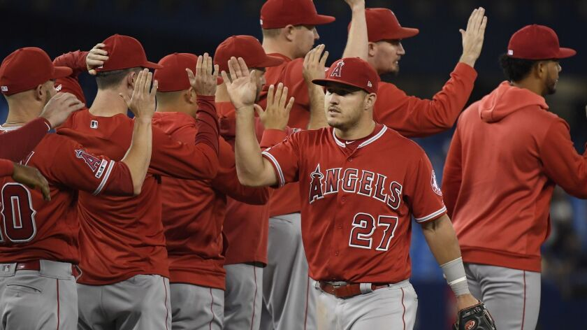 Los Angeles Angels' Mike Trout (27) celebrates with teammates after the Angels defeated the Toronto