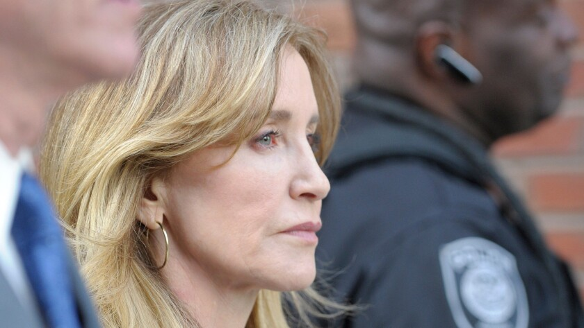 Felicity Huffman leaves court in Boston in April.