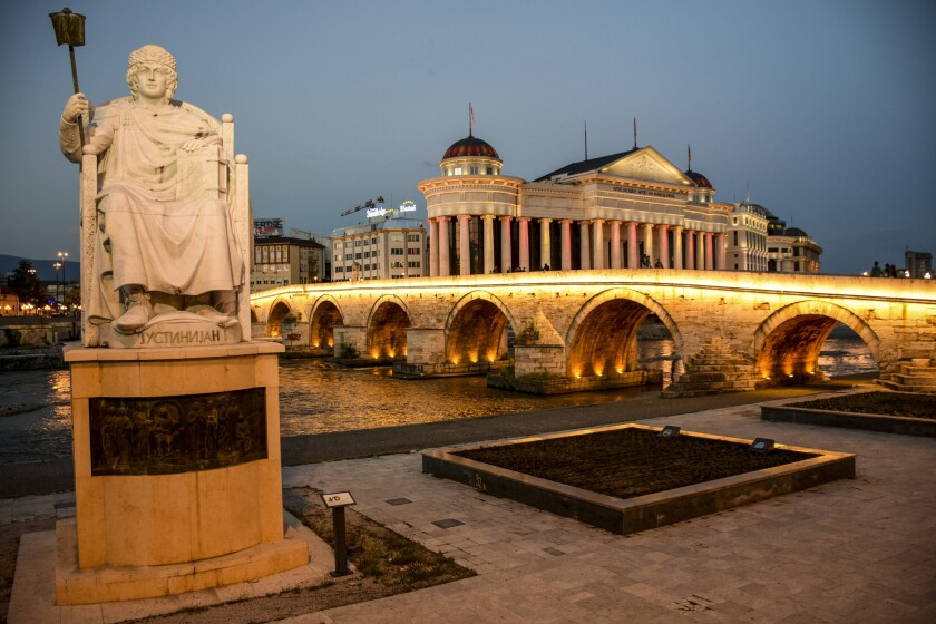 The historic Stone Bridge and the Archeological Museum in Skopje.
