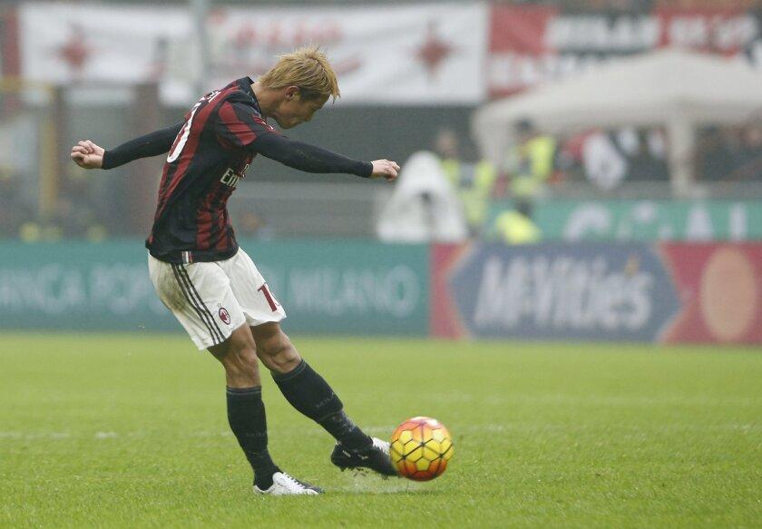 AC Milan's Keisuke Honda scores during a Serie A soccer match between AC Milan and Genoa, at the San Siro stadium in Milan, Italy, Sunday, Feb. 14, 2016. (AP Photo/Luca Bruno)