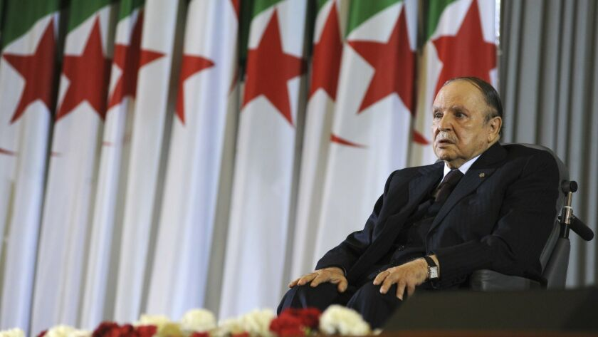 In this April 28, 2014, photo, Algerian President Abdelaziz Bouteflika sits in a wheelchair after taking the oath as president, in Algiers, Algeria.