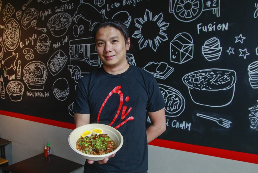 Jaypee Woo, at his Mercado del Barrio restaurant Oi Asian Fusion, serves vibrant Filipino-Japanese food, like the braised pork belly Adobo Bowl.