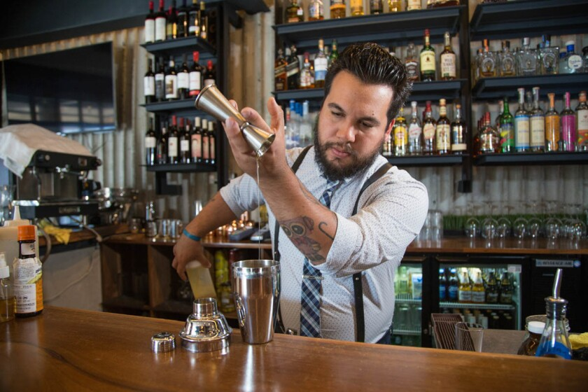 Fernando Villalobos head bartender/mixologist at ORYX Capital in Tijuana. (Alejandro Tamayo/Union Tribune)