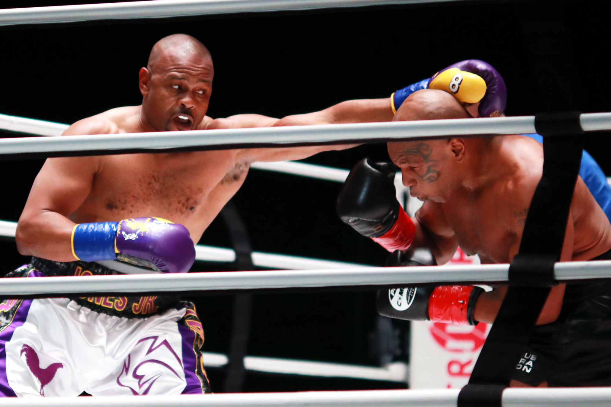 Roy Jones Jr., left, throws a punch at Mike Tyson during their exhibition fight at Staples Center.