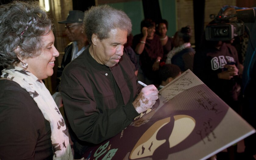"""Albert Woodfox signs a poster of the movie""""Black Panthers: Vanguard of the Revolution"""" at the Ashe Cultural Arts Center in New Orleans, Friday, Feb. 19, 2016. Earlier in the day Woodfox, the last of three high-profile Louisiana prisoners known as the """"Angola Three,"""" was released from Louisiana Stat"""