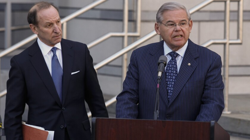 """U.S. Sen. Robert Menendez, with attorney Abbe Lowell, speaks outside federal court in Newark, N.J., after his arraignment. He will have difficulty fighting the """"false statements"""" felony charge over failing to report gifts."""