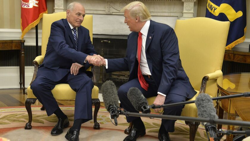 President Trump shakes hands with White House Chief of Staff John F. Kelly after he was sworn in July 31, 2017.