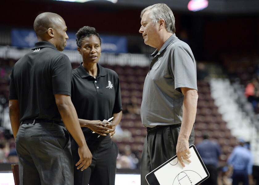FILE - In this May 4, 2016 file photo, San Antonio Stars coach Dan Hughes talks with assistant coaches James Wade, left, and Vickie Johnson, center, during the first half of the team's WNBA basketball exhibition game against the Atlanta Dream in Uncasville, Conn. Vickie Johnson has agreed in principle to be the next coach of the Dallas Wings, said a person familiar with the situation. The person spoke to The Associated Press Thursday, Dec. 3, 2020 on condition of anonymity to the AP because the no announcement of Johnson's hiring has been made. (AP Photo/Jessica Hill, File)