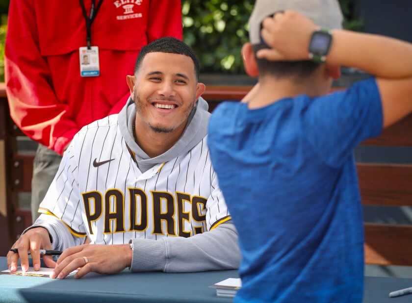 Manny Machado, shown with a young fan during FanFest on Saturday at Petco Park, says he feels better this offseason than any time in his eight-year career.