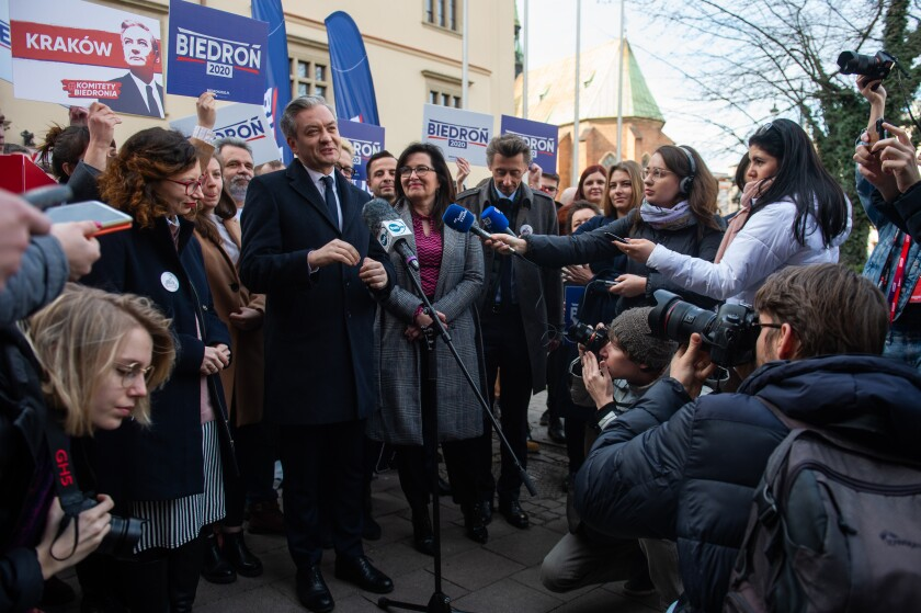 Robert Biedron speaks to the media before rallying with supporters in Krakow, Poland.