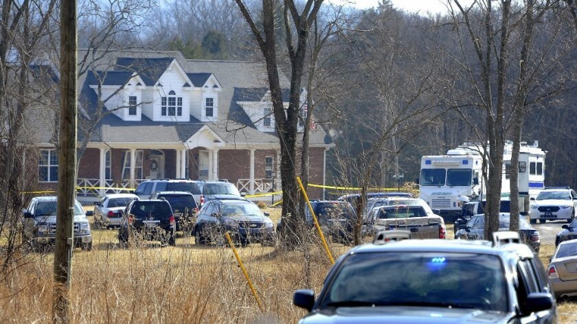 Emergency vehicles surround a home in Lebanon, Tenn., where a bomb exploded.