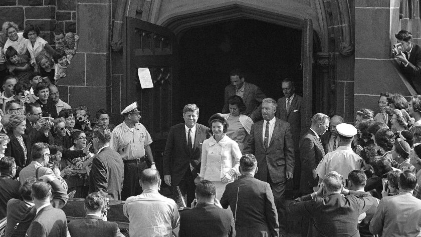 President John F. Kennedy and First Lady Jacqueline Kennedy leave St. Mary's Church in Newport, R.I., after Mass. The church, where the Kennedys wed on Sept. 12, 1953, is inviting visitors in to kneel where the couple knelt and imagine the day.