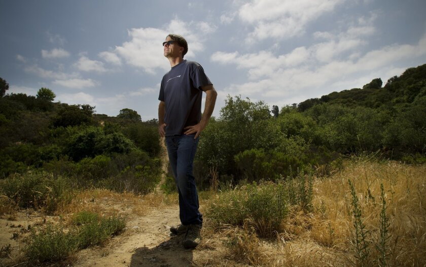 David Holway, an ecologist and evolutionary biologist at UC San Diego, stands in a field where he has been studying Argentine ants that have moved into the site -- which is near a residential neighborhood. / photo by Nelvin C. Cepeda * U-T