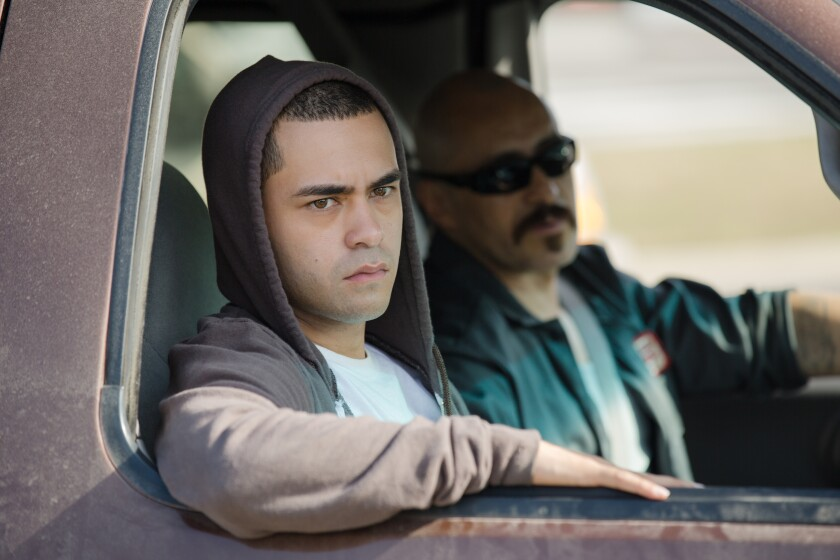 """Gabriel Chavarria  and Demian Bichir  in """"Lowriders."""" Credit: Justin Lubin / Universal Pictures"""