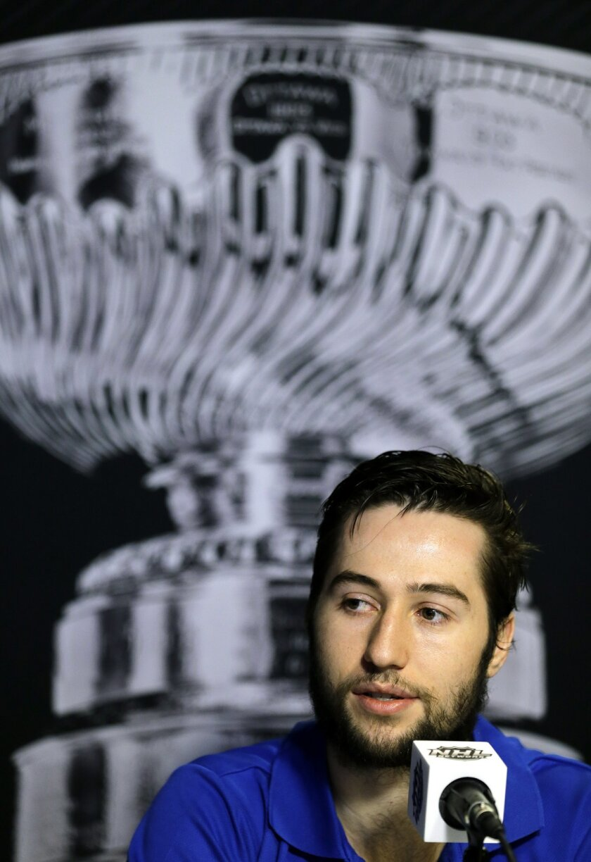Tampa Bay Lightning center Tyler Johnson answers a question during media day for the NHL hockey's Stanley Cup Finals Tuesday, June 2, 2015, in Tampa, Fla. The Lightning take on the Chicago Blackhawks in Game 1 on Wednesday.  (AP Photo/Chris O'Meara)